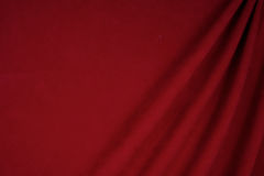 Dark red velvet fabric use for backdrop. Texture or background Royalty Free Stock Photo