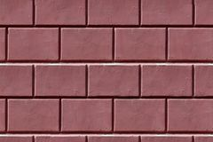 Dark red wall. Closeup of dark red brick wall outdoor. tiling, seamless Royalty Free Stock Photography
