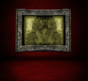 Dark  red wall with frame and floor interior Royalty Free Stock Photo
