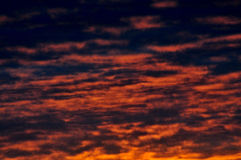 Dark reddish skies with heavy cloudscape. Effect of the evening's sunset royalty free stock photography
