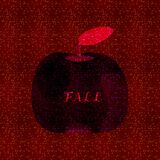 Dark reddish spotted background with deep silhouette of apple fruit Stock Photography