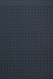 Dark regular plastic texture Stock Photography
