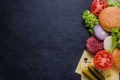 Dark restaurant menu, burger ingredients and copy space Royalty Free Stock Images