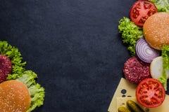 Dark restaurant menu, burger ingredients and copy space Stock Images