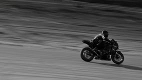 Dark rider. Ordinary track day on a race track of Saint-Petersburg Royalty Free Stock Photo