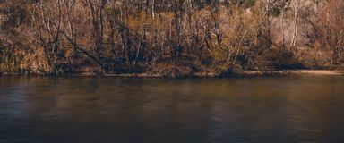 Dark river in late autumn stock photos