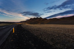 Dark road in north Iceland at sunset Stock Photo