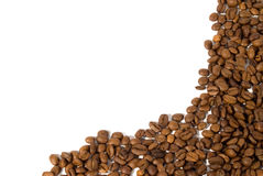 Dark Roast Coffee Beans. Coffee beans framing the right and bottom side of a white background Royalty Free Stock Image