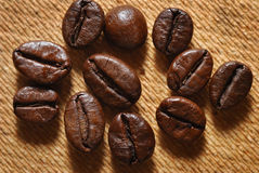 Dark roasted coffee beans royalty free stock photos