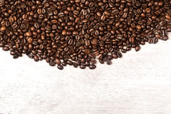 Dark Roasted Coffee Beans Caffeine Brown Espresso wallpaper close up. Fried Coffee Beans Texture macro.  royalty free stock photo