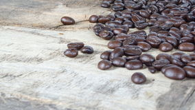 Dark roasted coffee beans. With milk put on a wood table Stock Photography