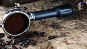 Dark roasted coffee beans. Put on a wood table Stock Photo