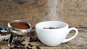 Dark roasted coffee beans. Put on a wood table Stock Images