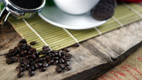 Dark roasted coffee beans. Put on a wood table Stock Image