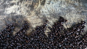 Dark roasted coffee beans. Put on a wood table Royalty Free Stock Photo