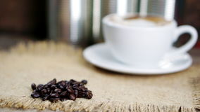 Dark roasted coffee beans. Put on a wood table Stock Photos
