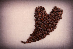 Dark roasted coffee beans  in the shape of a heart Royalty Free Stock Image