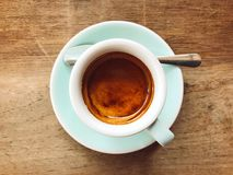 Dark roasted espresso. A cup of dark roasted espresso coffee place on a wooden Royalty Free Stock Images