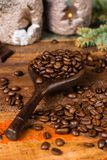 Dark roasted pure arabica coffee beans and ground coffe on the w Stock Photo