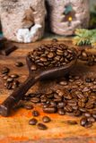 Dark roasted pure arabica coffee beans and ground coffe on the w Stock Image