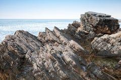 Dark rocks of Adriatic Sea coast Royalty Free Stock Photos