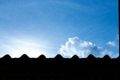 Dark roof. Blue sky with cloud over silhouette roof Royalty Free Stock Photography