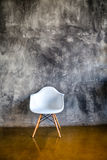 Dark room with armchair in modern style Royalty Free Stock Image