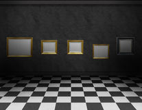 Dark room with frames and black and white floor Stock Photography