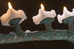 In dark room lit candles on candlesticks Stock Photos