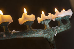 In dark room lit candles on candlesticks Stock Images