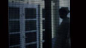 Dark room with a nurse. A medium shot of a dark room with a nurse stock footage