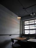 Dark room with orange light and backlited window stock photo