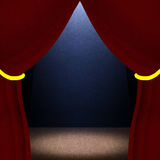 Dark room with red curtains and stage lighting Stock Image