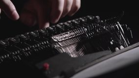 Script writer prints the text on a typewriter stock video footage
