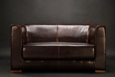 A dark room with sofa Stock Image