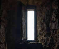 Dark room with stone walls and window Stock Photography