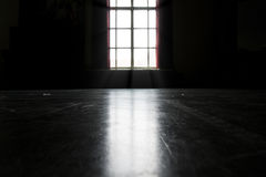 Dark room with window Royalty Free Stock Photography