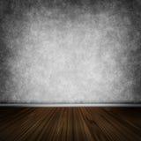 Dark room with wooden floor Stock Photography