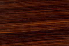 Dark rosewood background, natural wooden texture with patterns. Extremely high resolution photo Stock Images
