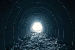 Dark round tunnel with light in the end, abstract way to freedom and hope in happy life concept.  royalty free stock photos
