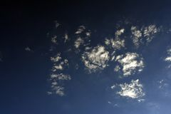 Dark royal blue cloudscape. Royal dark blue cloudscape with soft wispy clouds Stock Photos