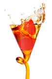 Dark rum shot. A shot of dark rum with a cherry splash Stock Images