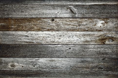 Dark rustic barn wood texture. Dark rustic weathered barn wood background with planks, knots and nail holes Stock Image