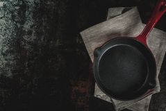 Dark rusty culinary background. With empty black pan, top view copy space Stock Image