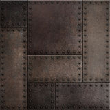 Dark rusty metal plates with rivets seamless background or texture Royalty Free Stock Image