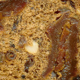 Dark rye bread  texture. Dark rye bread with some dried fruits texture Royalty Free Stock Image