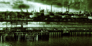 Dark Satanic Mills. Oil refinery at Fawley from Southampton Water, England, during a demonic storm Stock Image
