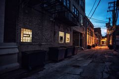 Dark and scary downtown urban city street alley scene at night stock photos
