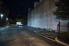 Dark and scary empty downtown urban city parking lot at night stock image