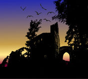 Dark scary halloween landscape with silhouette of castle and birds Royalty Free Stock Images